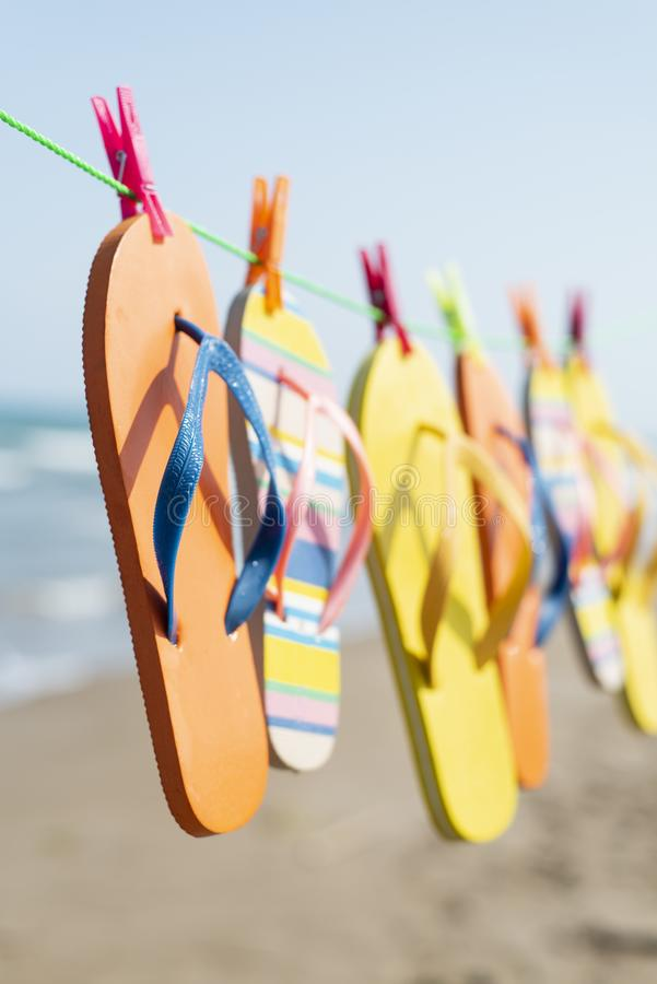 Flip-flops hanging on a clothes line stock images