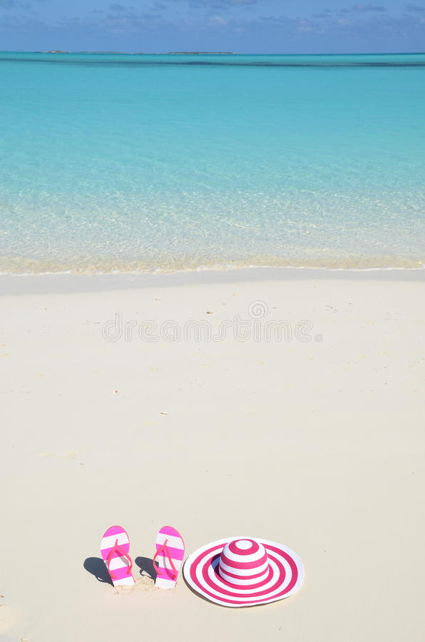 Flip-flops and hat. On the beach stock image