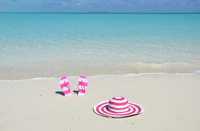 Flip-flops and hat. On the beach stock photography
