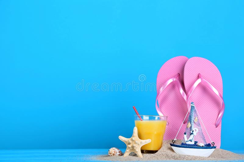 Flip flops with juice royalty free stock photo