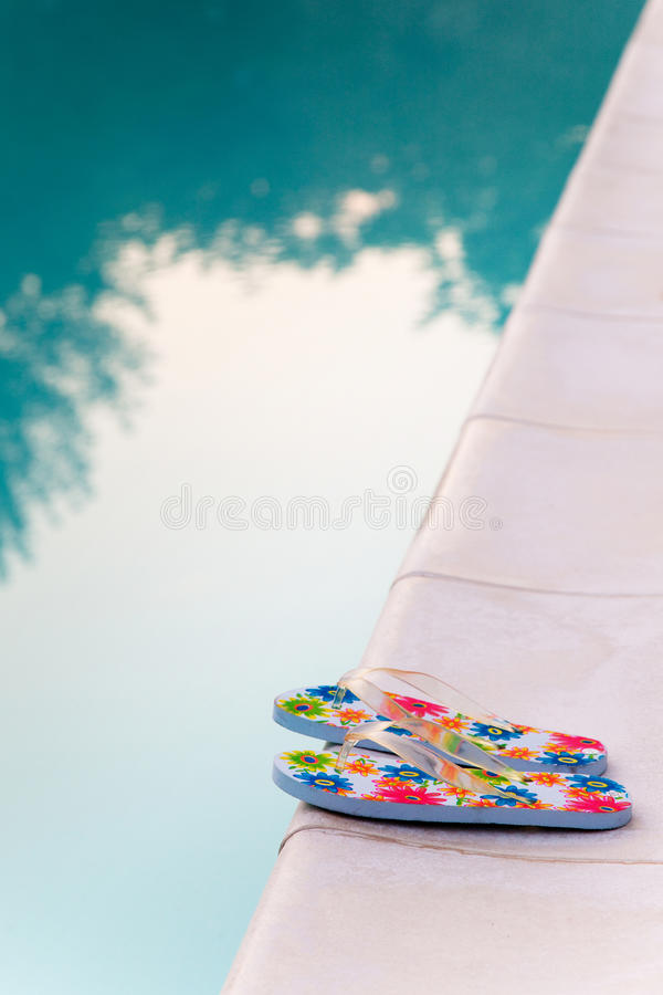 Download Flip-flops Near The Swimming-pool Royalty Free Stock Images - Image: 18590519