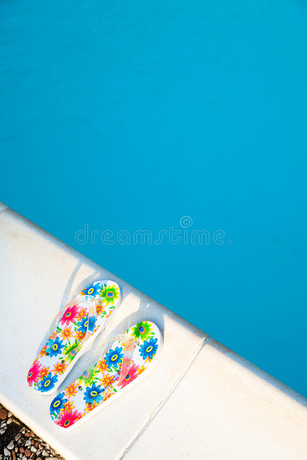 Download Flip-flops Near The Swimming-pool Stock Image - Image: 18590561