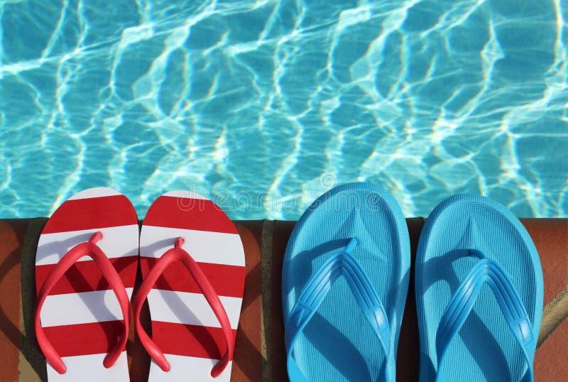 Flip flops on pool side royalty free stock photo