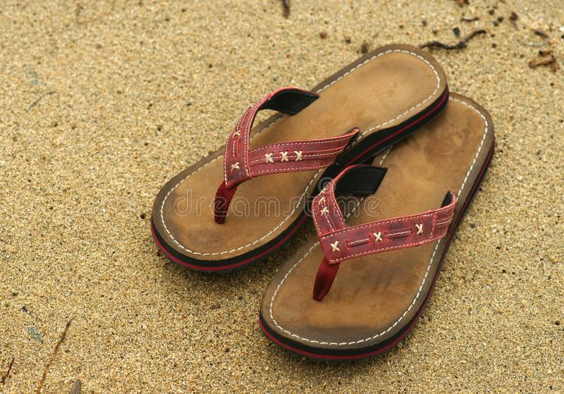 Flip-flops. Sand stock photos