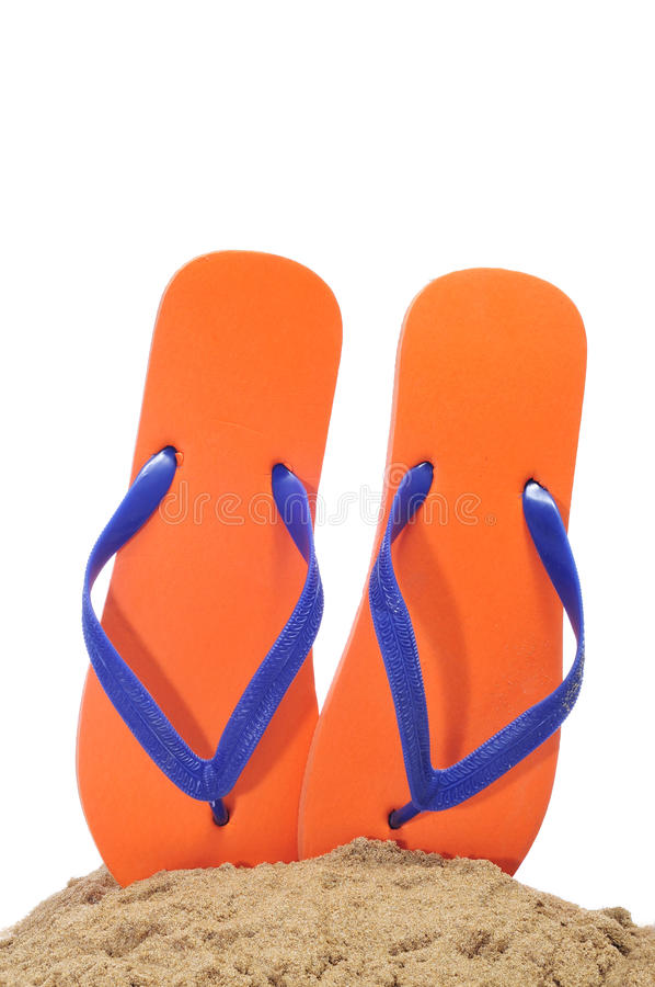 Flip-flops on the sand royalty free stock photos