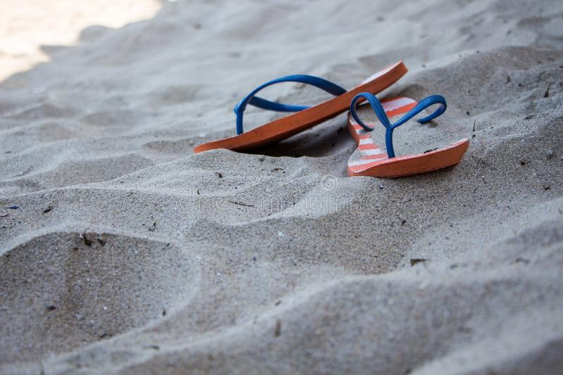 Flip flops in sand. royalty free stock image