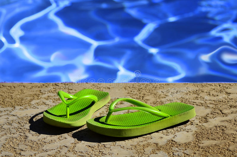Flip Flops Sandals by Swimming Pool royalty free stock image