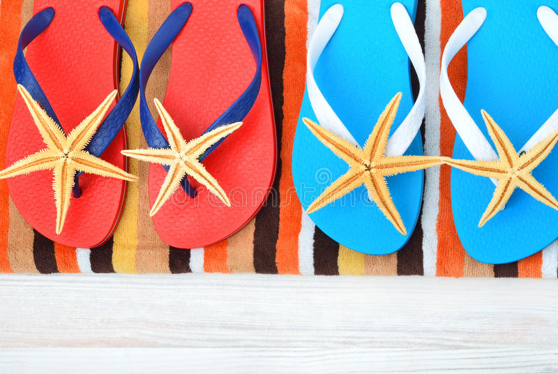 Flip flops and starfish laying. royalty free stock image