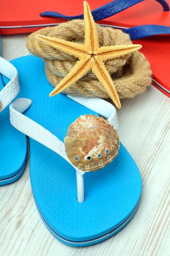 Flip-flops, starfish and seashells. stock images