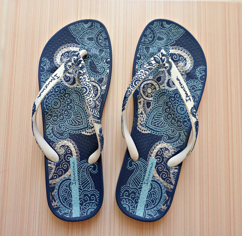 Flip flops. Stylish blue flip-flops with patterns. Photo taken on: May 2016 royalty free stock image