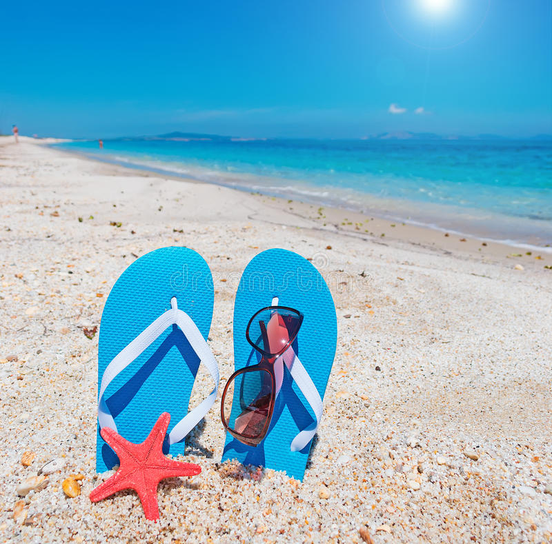 Flip-flops and sun. Glasses by the sea royalty free stock photo