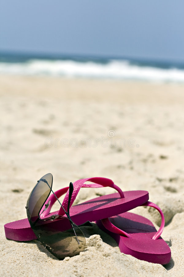 Flip flops and sunglasses stock photography