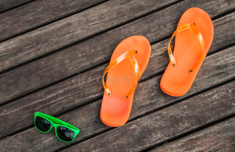 Flip-flops and sunglasses royalty free stock images