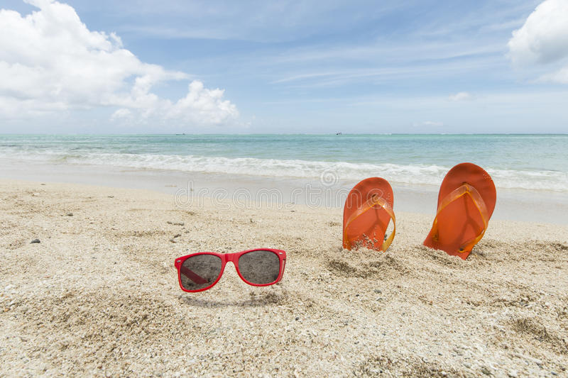 Flip-flops and sunglasses royalty free stock photo