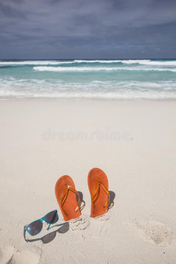 Flip-flops and sunglasses stock photography