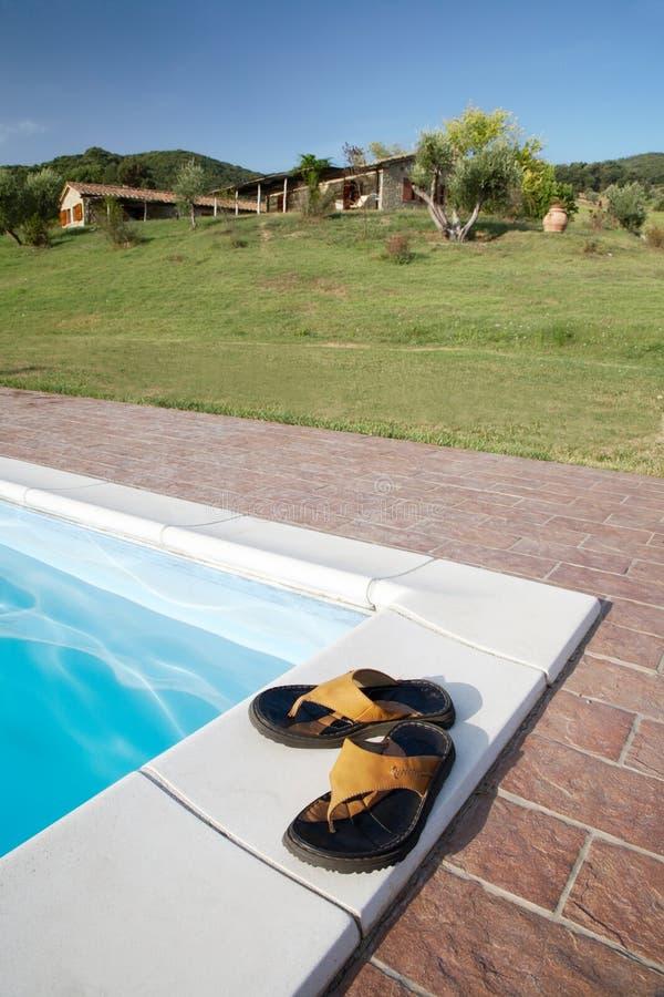 Flip-flops swimming-pool royalty free stock images