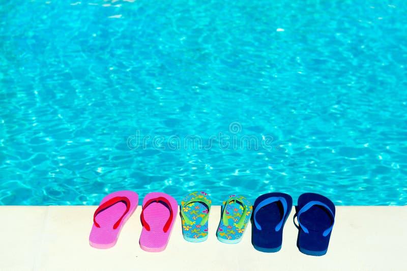 Flip flops at swimming pool stock photos