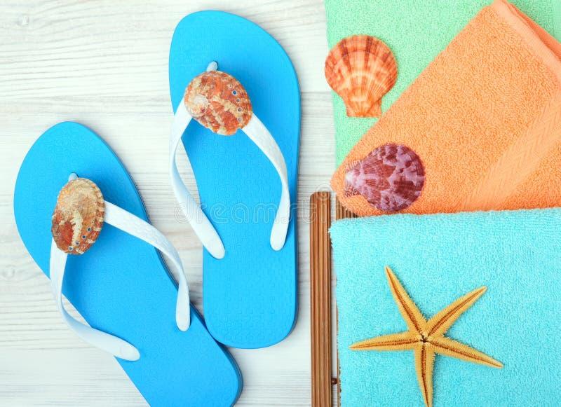 Flip-flops, towel, starfish and seashells. royalty free stock images