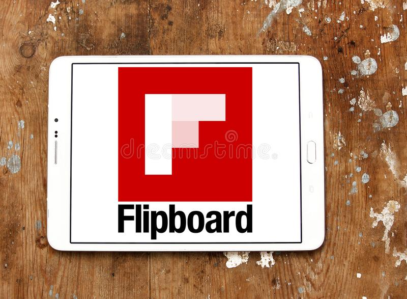 Flipboard logo. Logo of Flipboard on samsung tablet on wooden background. Flipboard is a news aggregation and social network aggregation company. It aggregates royalty free stock image
