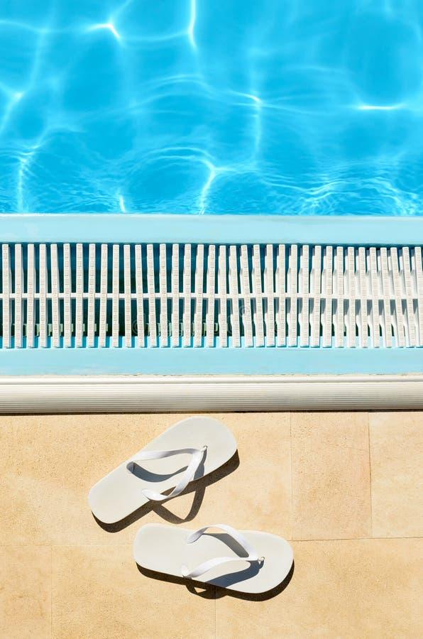 Flipflops summer pool royalty free stock photos