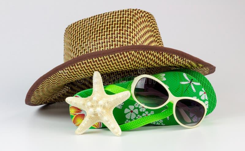 Flipflops und sunhat mit Starfish stockfotos