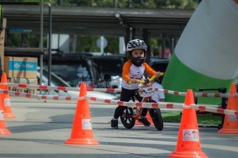 Flipper Balance Bike Chiangrai Championship, Children participate in balance bicycle race. Chiang Rai, Thailand - November 12, 2017 : Flipper Balance Bike royalty free stock photography