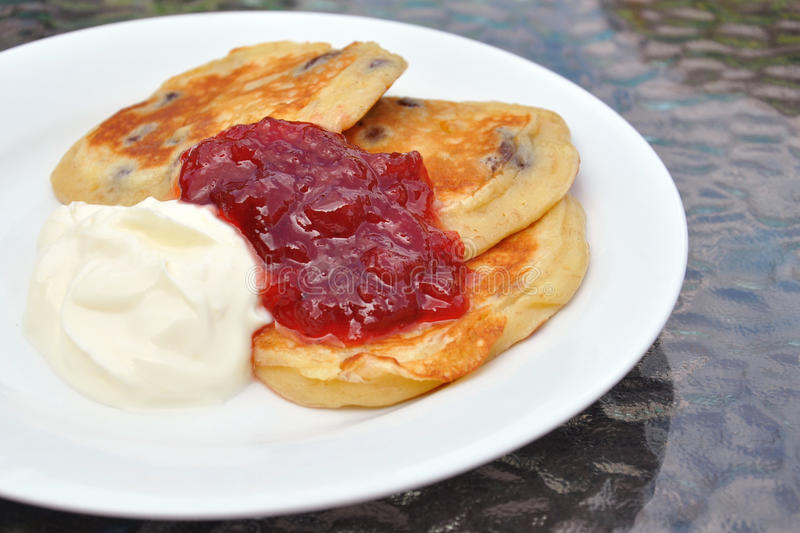 Download Flippers, Jam And Cream On White Plate Stock Photo - Image: 20537214