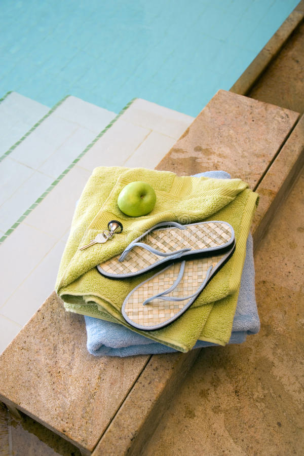 Flips flops by swimming pool royalty free stock photography