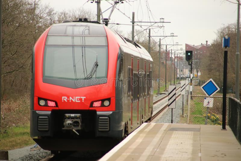Flirt train at a track at Waddinxveen of R-NET, runned by Albellio in the Black and red colors stock image