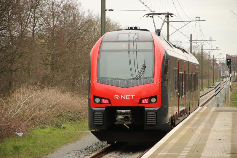 Flirt train at a track at Waddinxveen of R-NET, runned by Albellio in the Black and red colors. stock image
