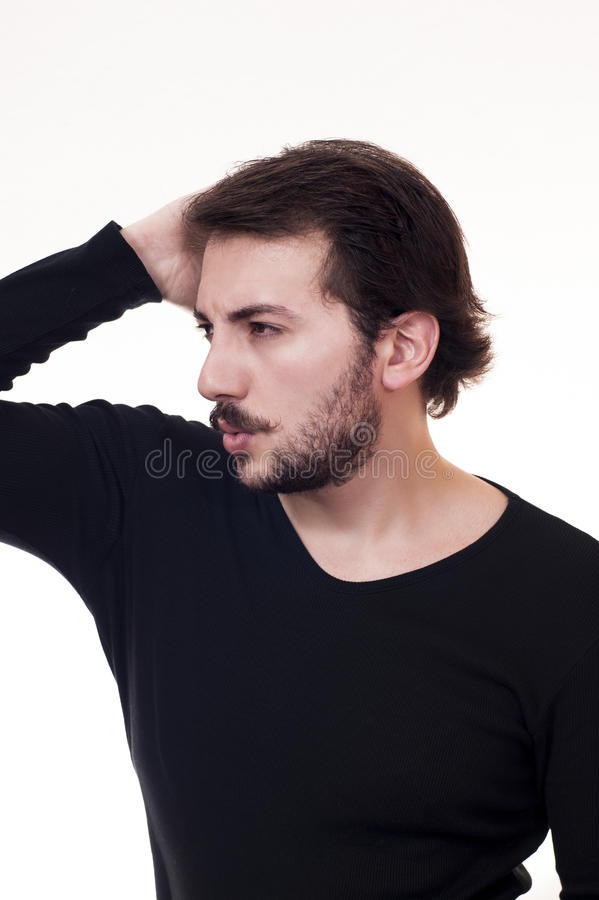 Flirtatious glance. Male touching to his hair royalty free stock photos