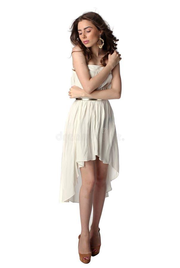 Flirterig meisje in witte kleding stock fotografie