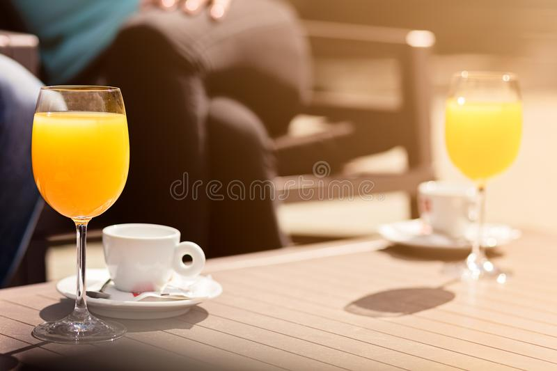 Flirting in a cafe. Beautiful loving couple sitting in a cafe enjoying in coffee and conversation. Love, romance, dating stock image