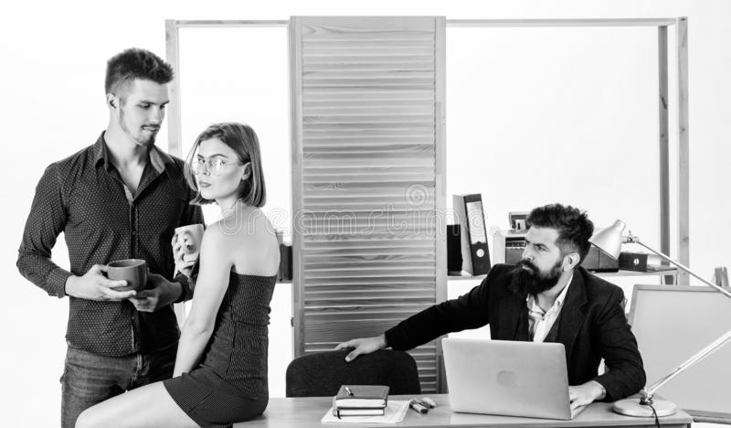 Flirting with coworker coffee break. Woman flirting with coworker. Woman attractive working male colleagues. Office stock photography