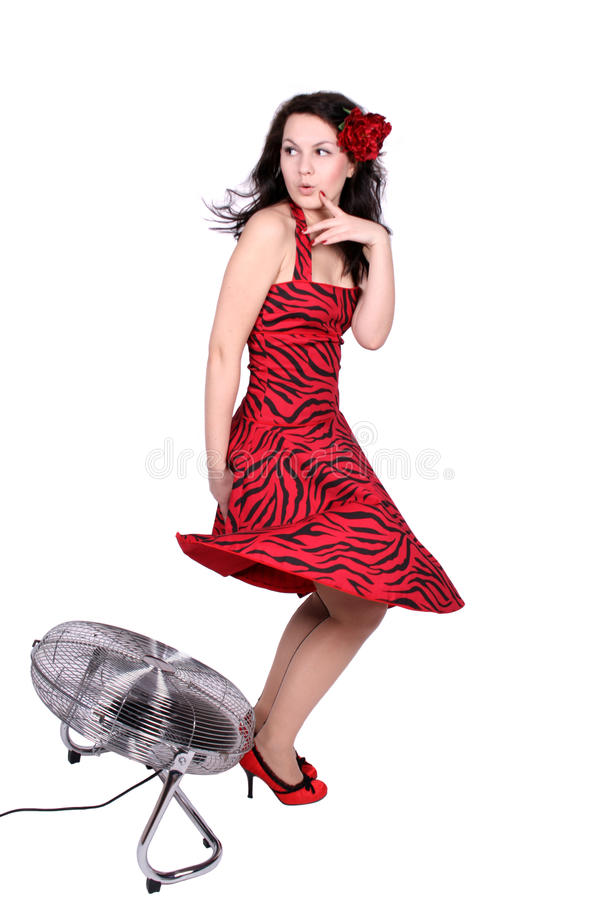 Flirting pinup girl standing near ventilator royalty free stock photos
