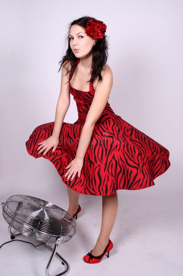 Flirting pinup girl standing near ventilator stock photo