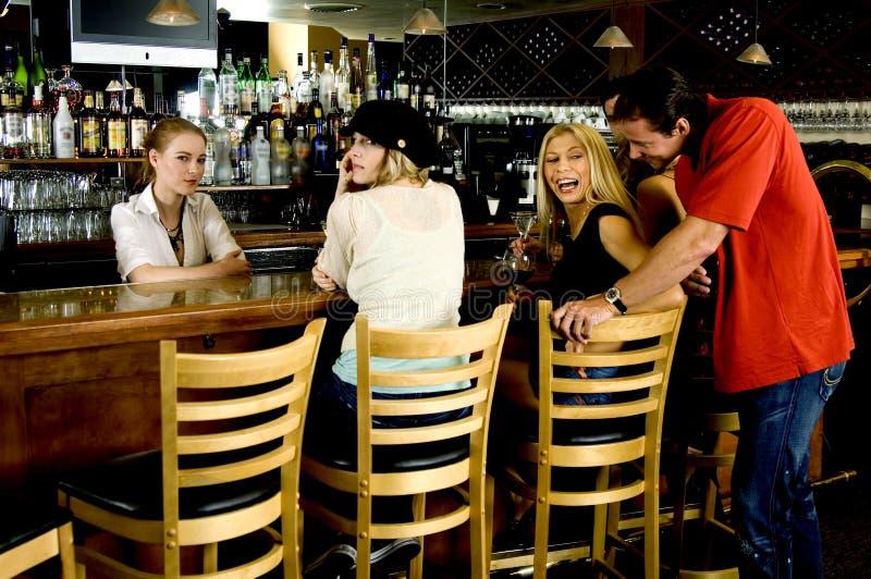 Flirting at the pub royalty free stock photography