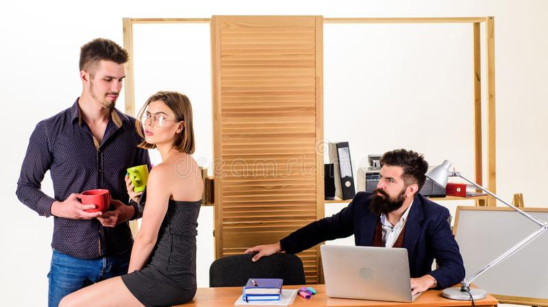 Flirting and seduction. Flirting with coworker coffee break. Woman flirting with coworker. Woman attractive working male. Colleagues. Office romance concept stock photos