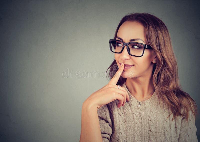 Flirting young girl in eyeglasses royalty free stock photos