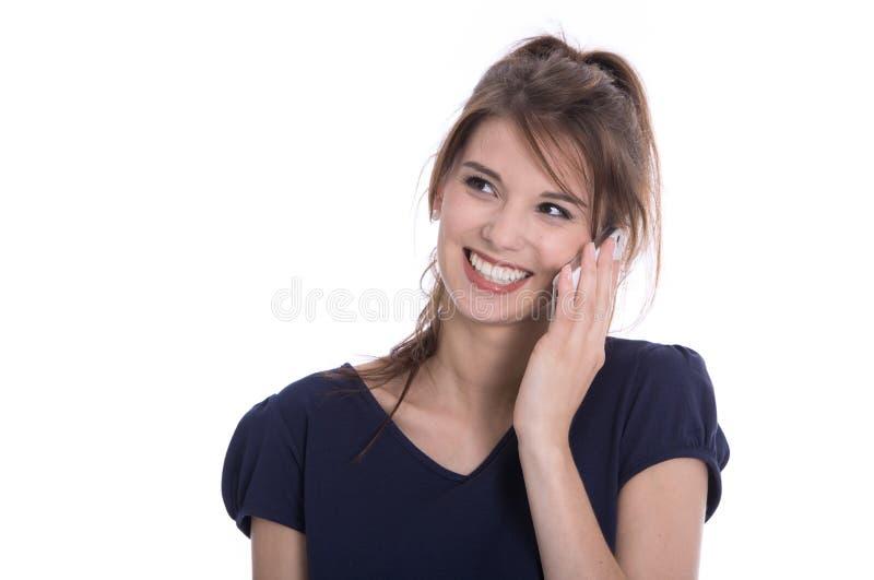 Flirtujący młodej kobiety na telefonie - odizolowywającym nad bielem. zdjęcia stock