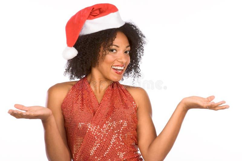 Flirty ethnic Mrs Santa Claus wearing hat royalty free stock photos