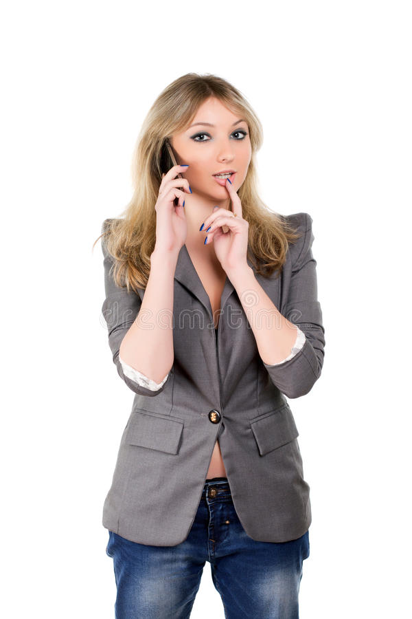 Flirty woman with a phone royalty free stock photography