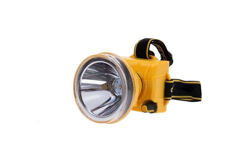 Flitslichthoofd koplamp, op witte achtergrond wordt geïsoleerd die Het kleine flitslicht met riemen voor hoofd heeft een het knip royalty-vrije stock afbeelding