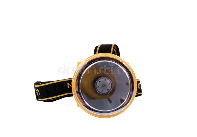 Flitslichthoofd koplamp, op witte achtergrond wordt geïsoleerd die Het kleine flitslicht met riemen voor hoofd heeft een het knip royalty-vrije stock foto