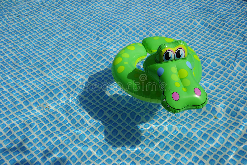 Float. In the swimming pool stock image