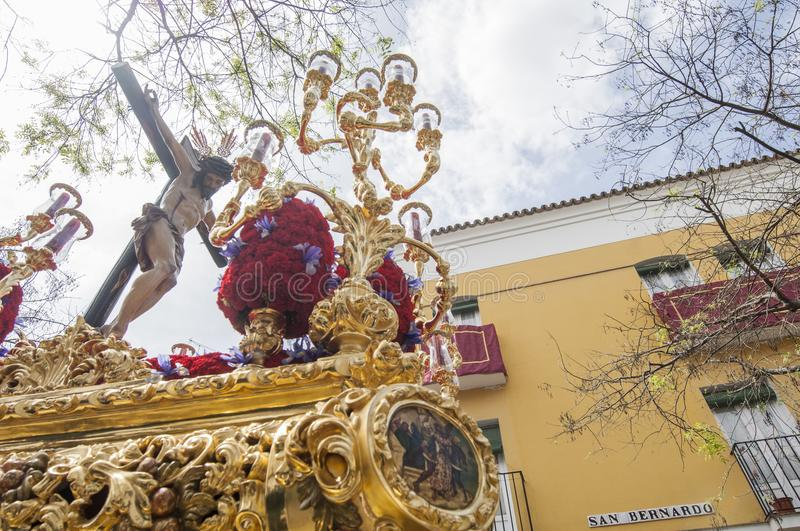 Float of Christ of the brotherhood. Of `San Bernardo` during its penitential journey on Holy Wednesday stock images