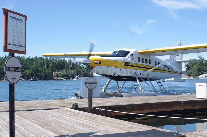 Float plane arrives at the pier stock images