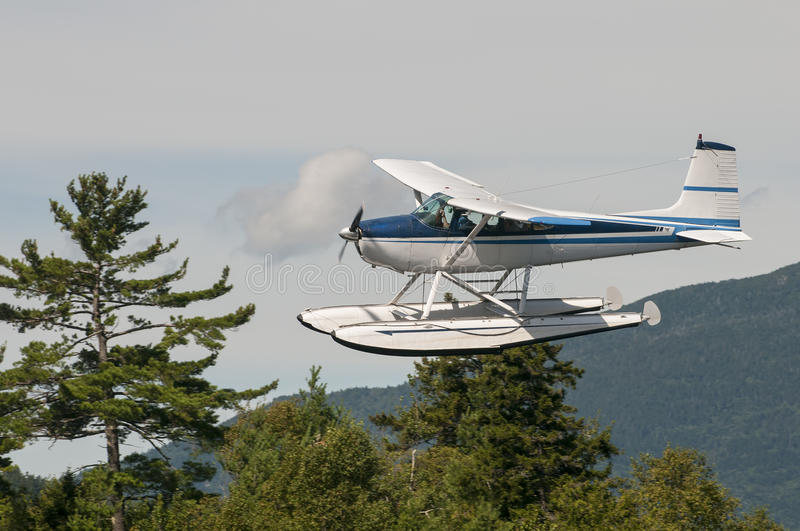 Float plane or seaplane. Flying float plane or seaplane circling in the sky for a landing royalty free stock photos