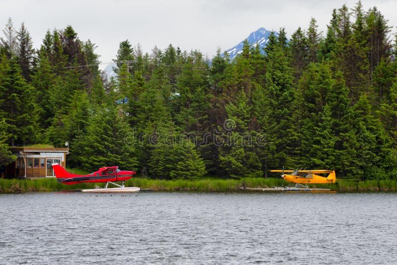 Float Planes on Beluga Lake Homer, Alaska. Float Planes sit tied to docks on Beluga Lake in Homer, Alaska royalty free stock photos