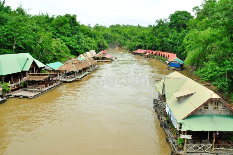 Float raft downstream. At River Kwai stock photos